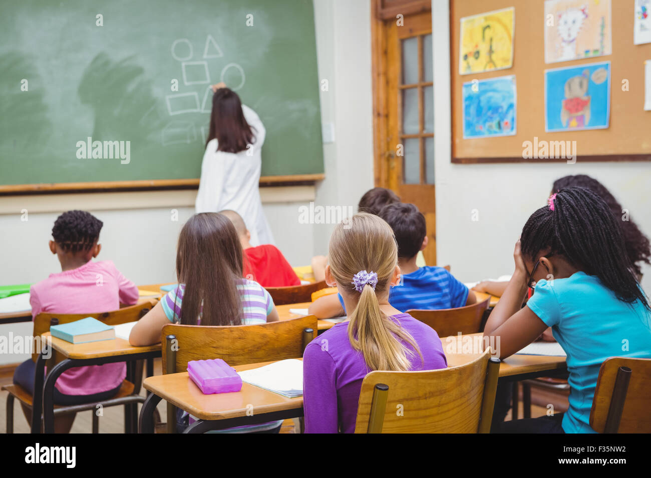 Students paying attention to the teacher - Stock Image