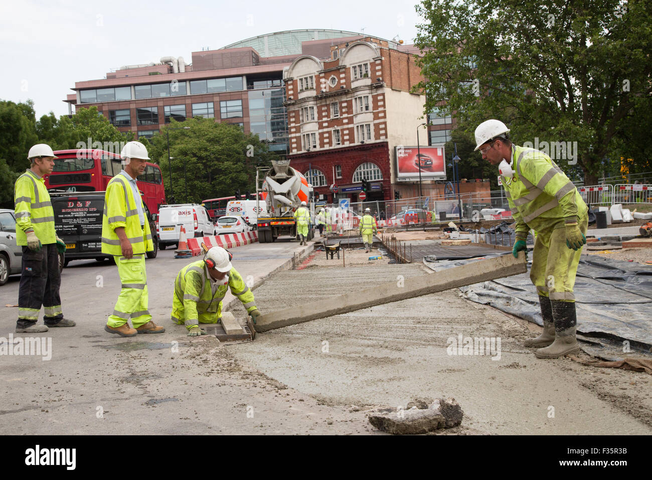 Workers begin to modernise the northern roundabout at Elephant & Castle, London. - Stock Image