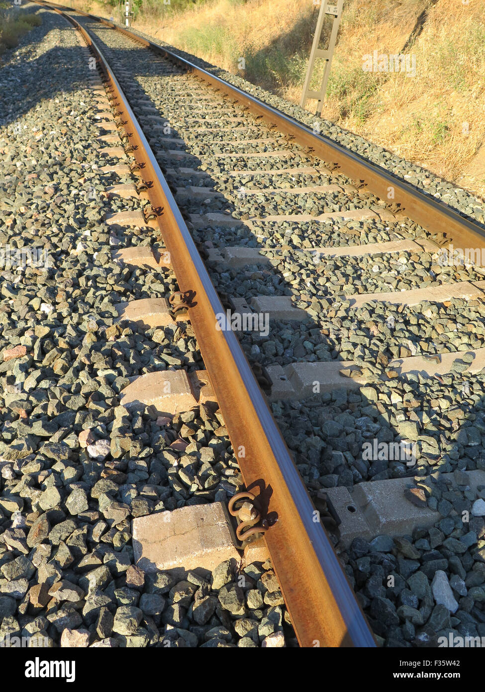 Railway track in ballast on local line between Alora and Malaga, Andalucia Stock Photo