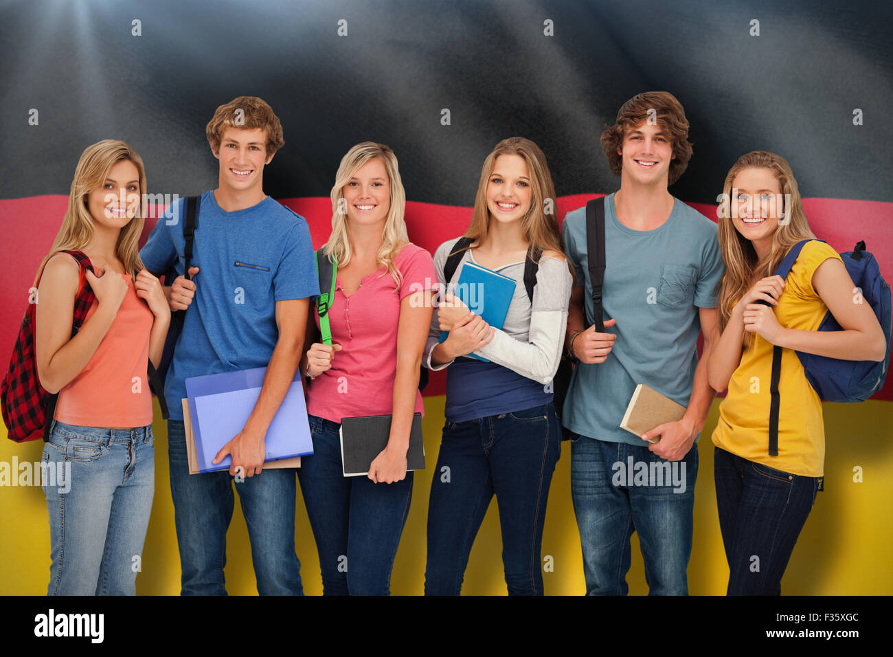 Composite image of smiling students all geared up for college - Stock Image