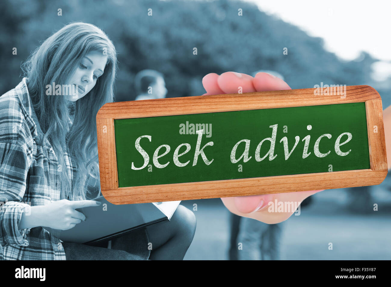 Seek advice against pretty student studying outside on campus - Stock Image