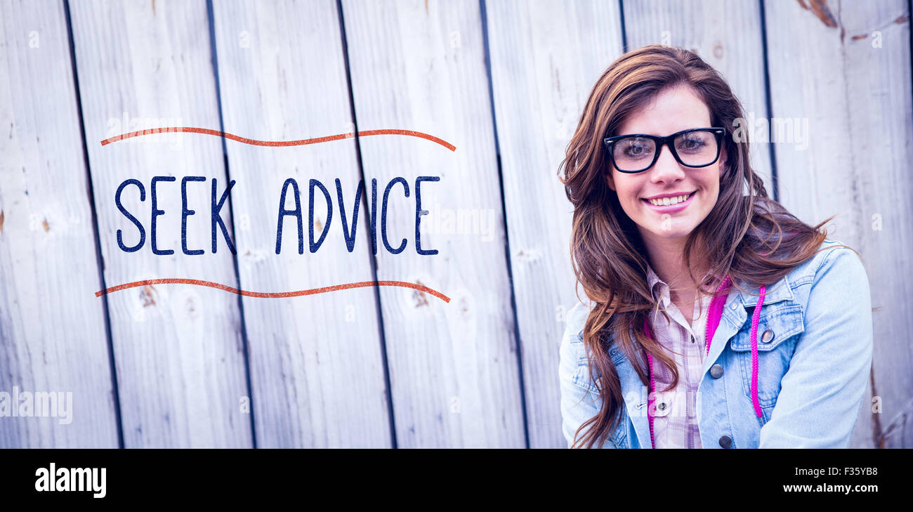 Seek advice against pretty woman smiling at camera - Stock Image