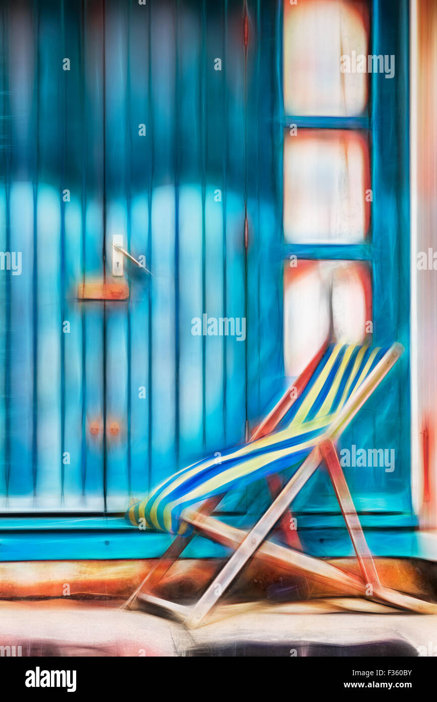 Abstract - empty deckchair outside beach hut at Bournemouth in September with Fractalius filter applied - Stock Image