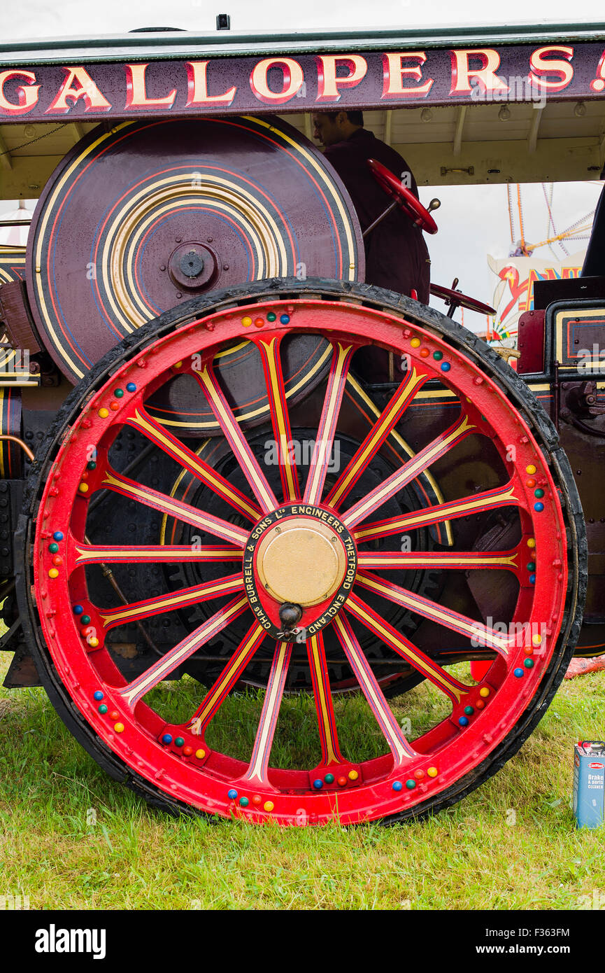 Huge driving wheel on Burrell steam Showman's engine - Stock Image