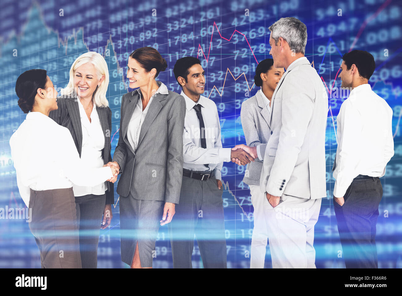 Composite image of business people speaking together - Stock Image