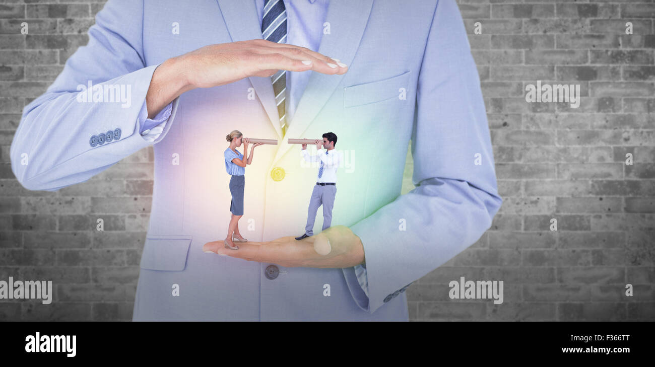 Composite image of business people looking at each other - Stock Image