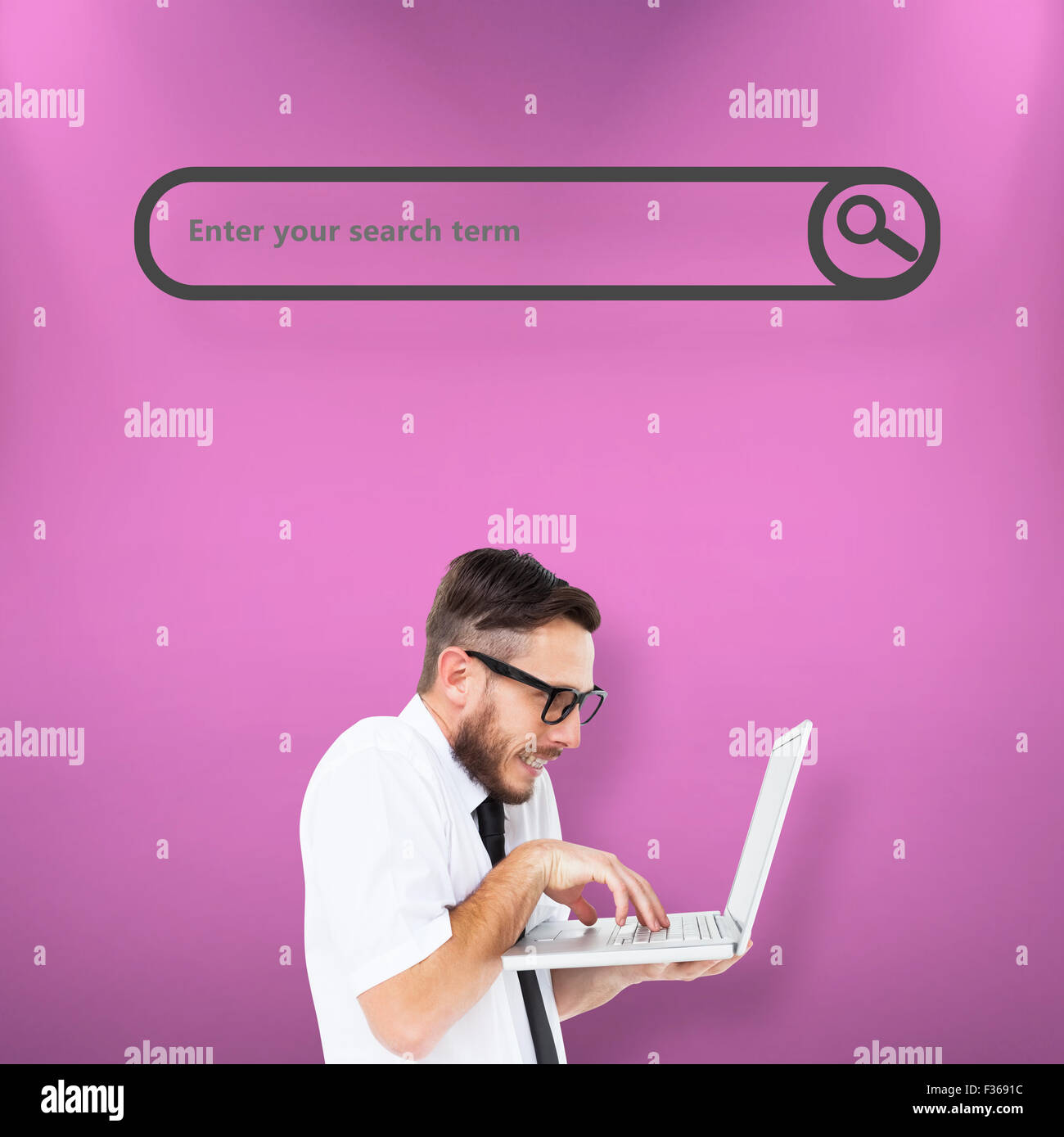 Composite image of geeky businessman using his laptop - Stock Image