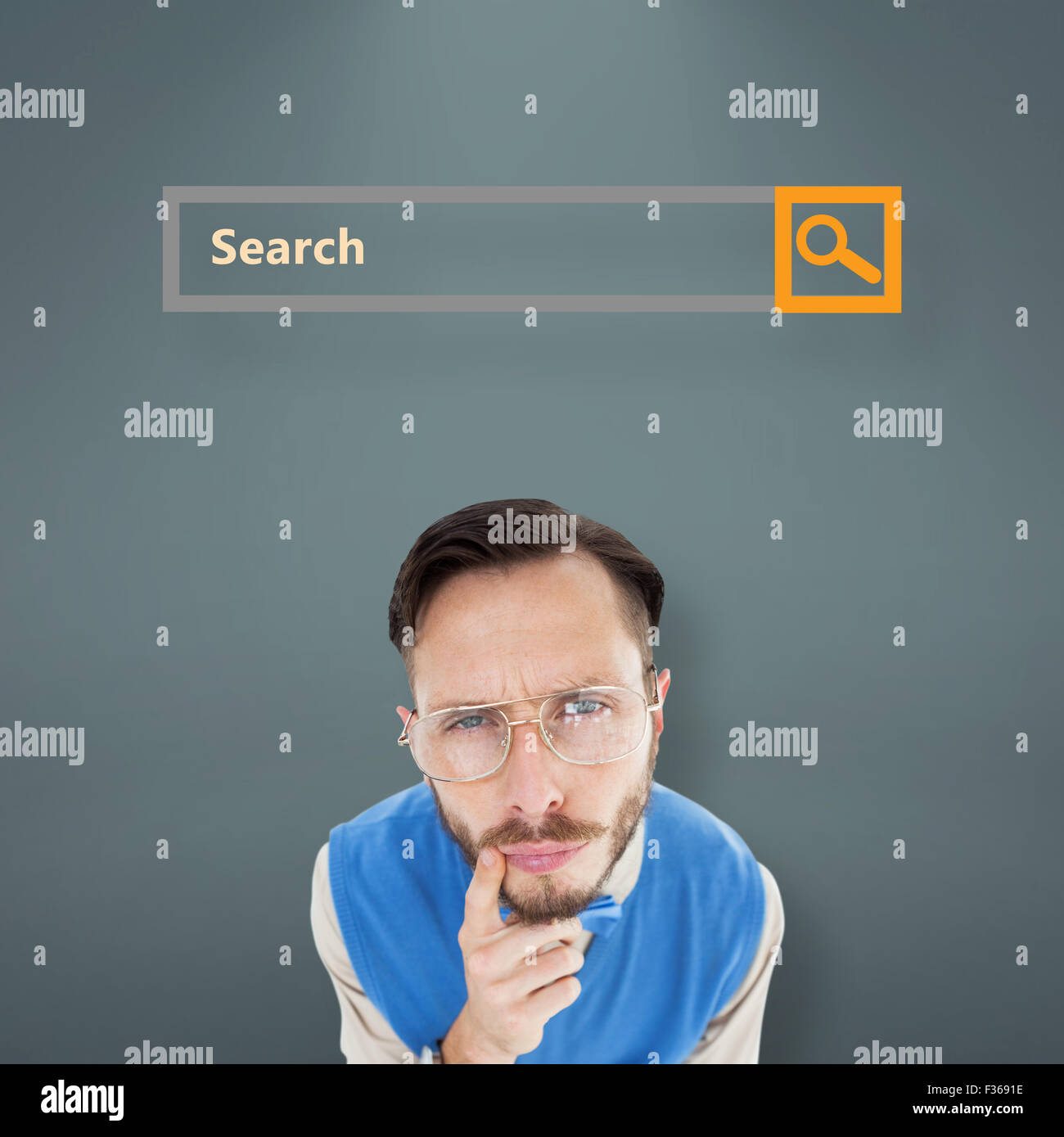 Composite image of geeky hipster looking at camera - Stock Image