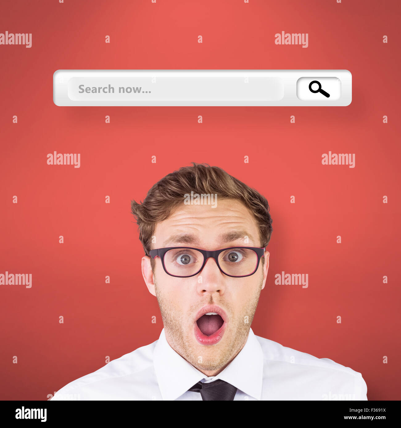 Composite image of geeky businessman looking at camera - Stock Image