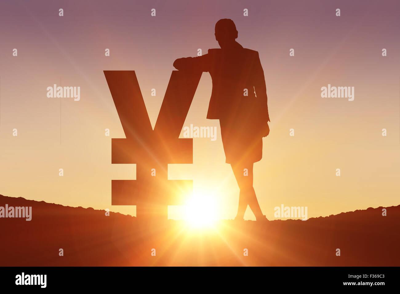 Composite image of silhouette beside yen symbol - Stock Image