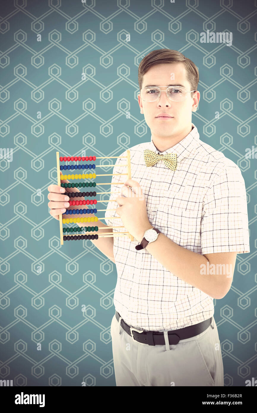 Composite image of geeky hipster holding an abacus - Stock Image