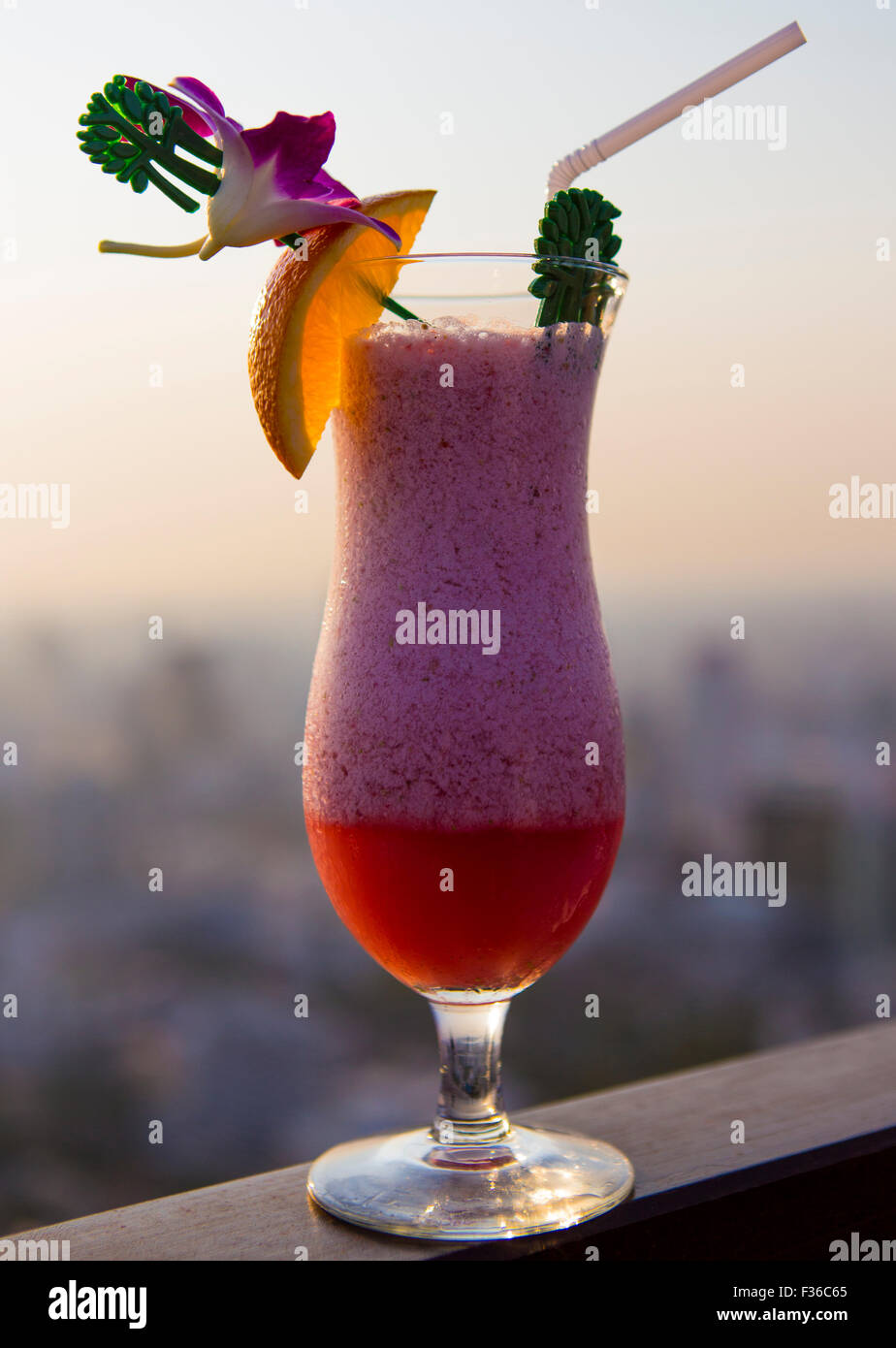 Glass standing on the balcony of the Sky-bar in the Banyan Tree Hotel in Bangkok - Stock Image