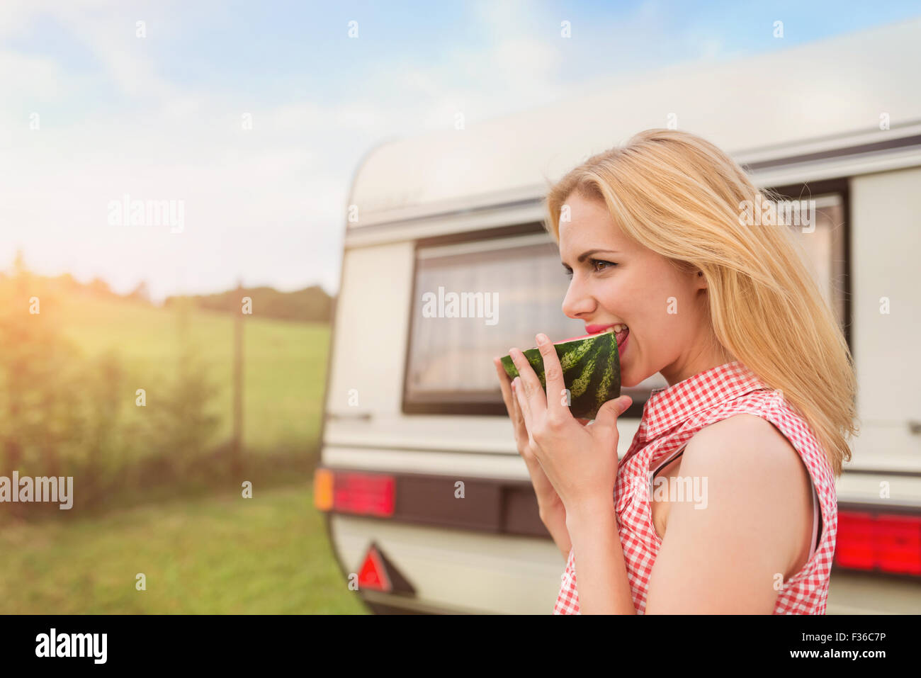 Beautiful woman outside the camper van - Stock Image
