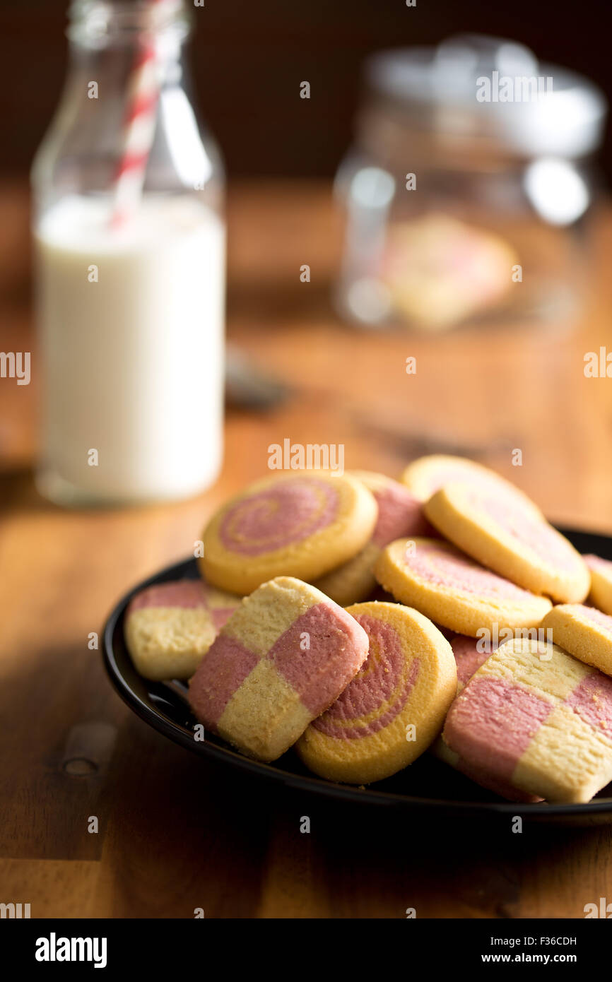 colored butter biscuits on kitchen table - Stock Image