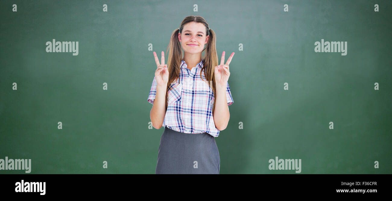 Composite image of geeky hipster smiling at camera - Stock Image