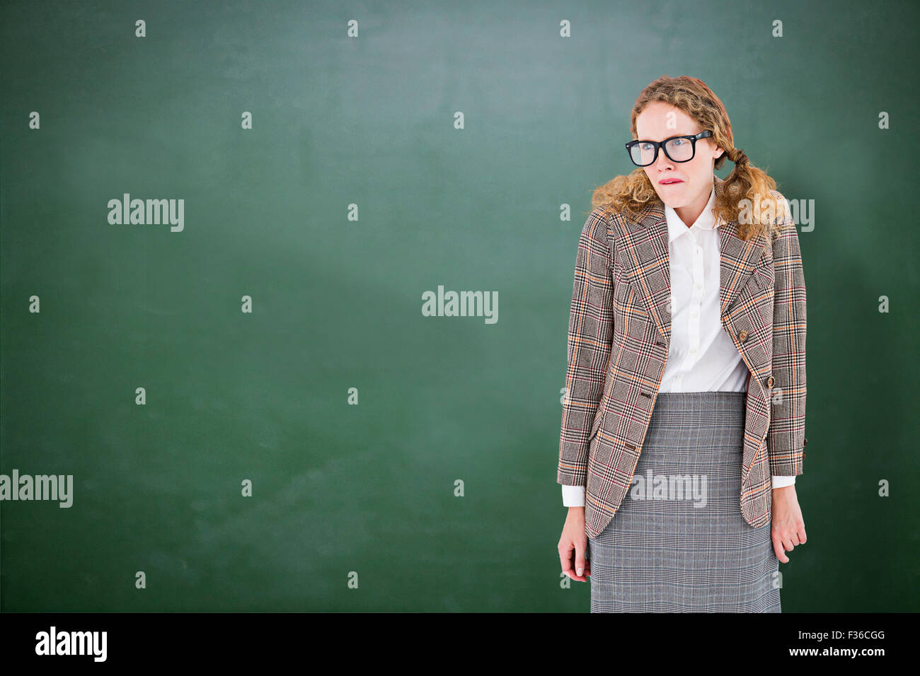Composite image of geeky hipster woman looking nervous - Stock Image
