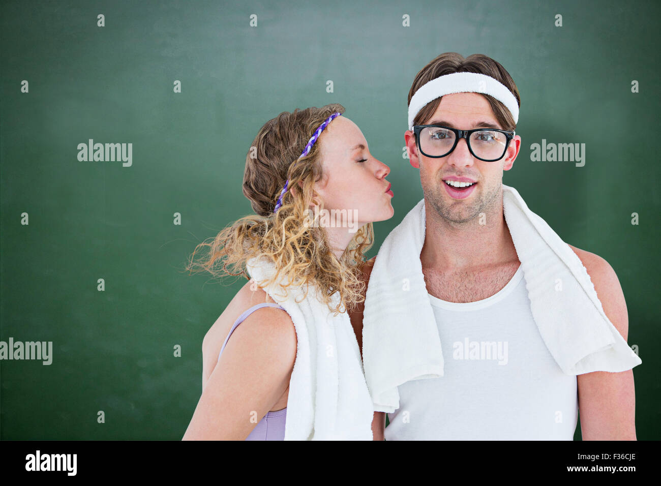 Composite image of geeky hipster kissing her boyfriend - Stock Image