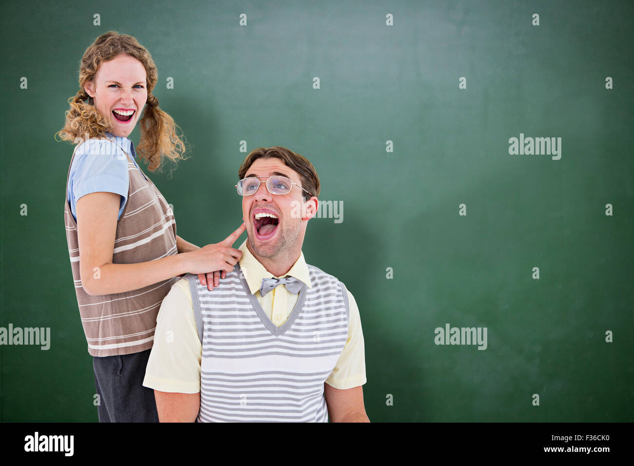 Composite image of excited geeky hipster couple - Stock Image