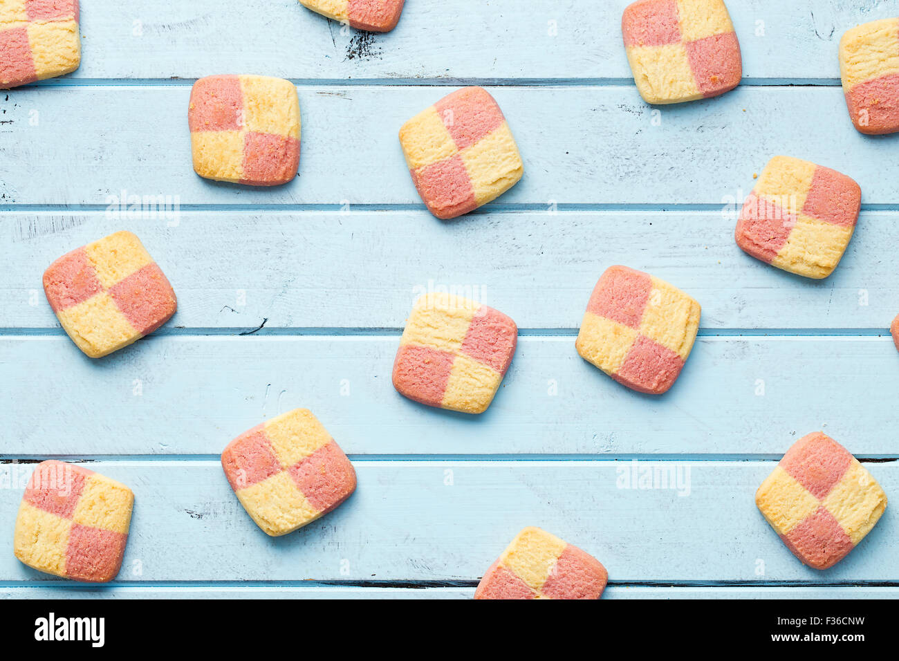 colored butter biscuits on blue table - Stock Image
