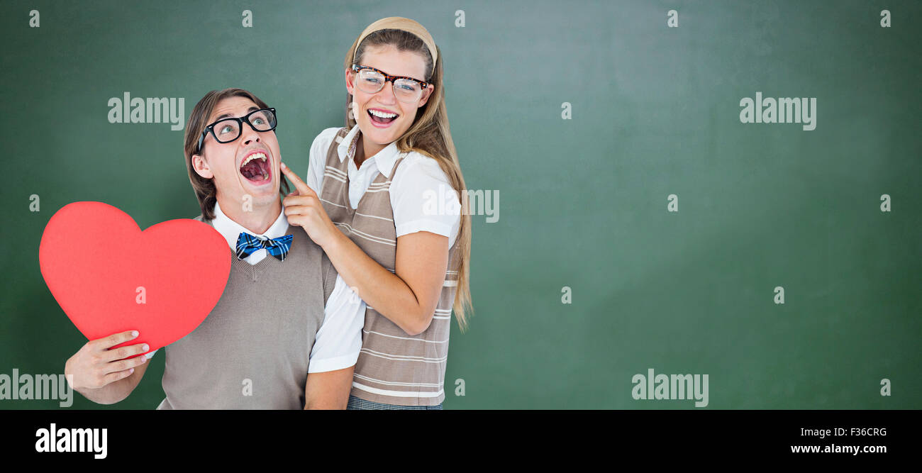 Composite image of excited geeky hipster and his girlfriend - Stock Image