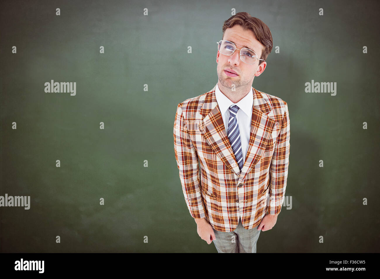 Composite image of geeky hipster looking up - Stock Image