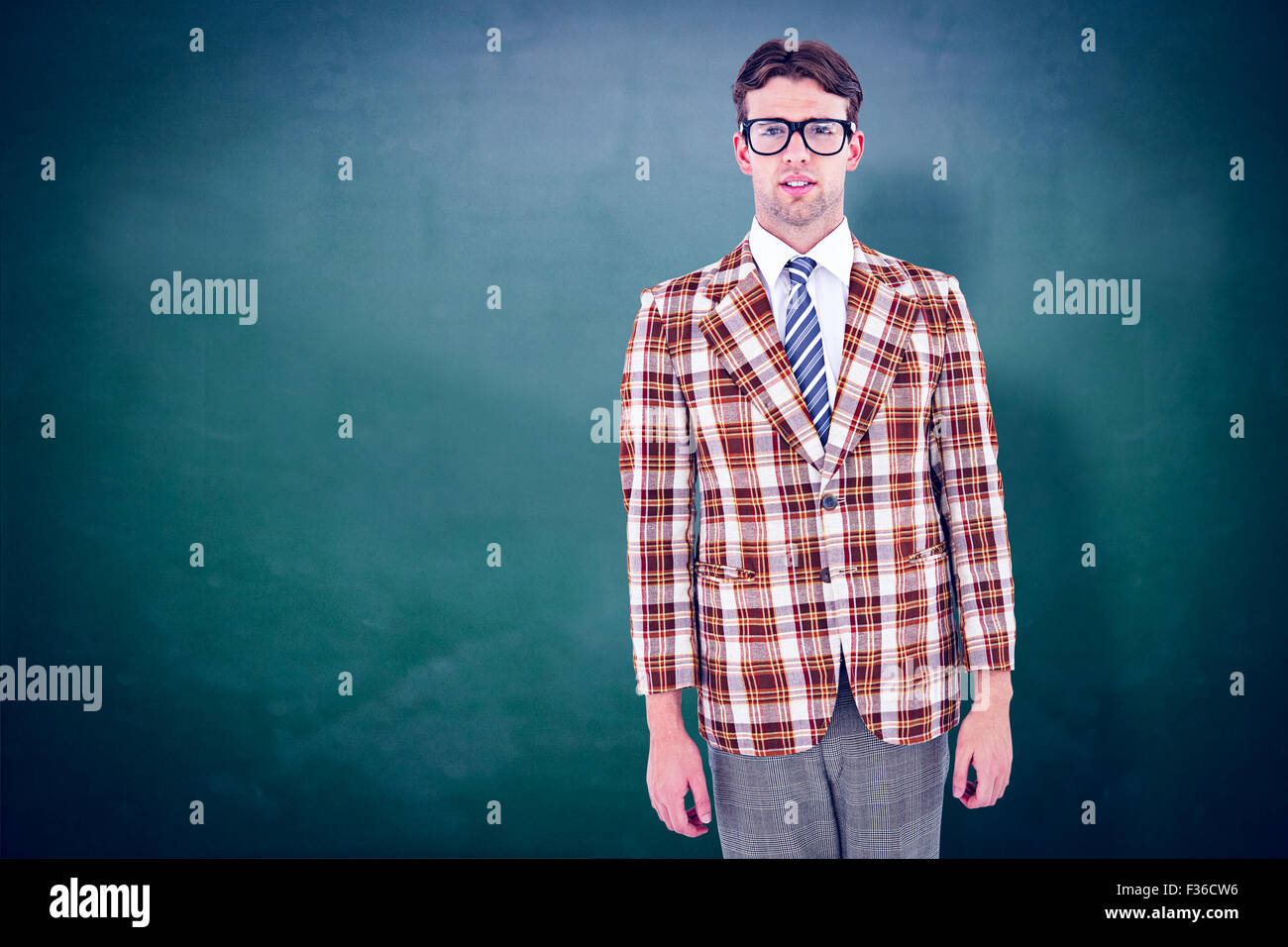 Composite image of geeky hipste rlooking at camera - Stock Image