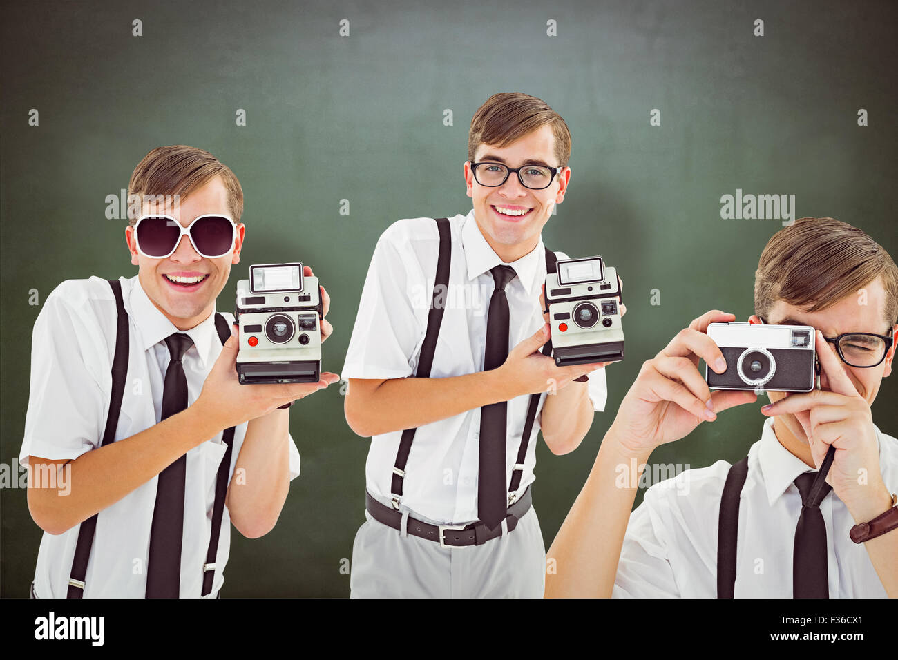 Composite image of geek with camera - Stock Image