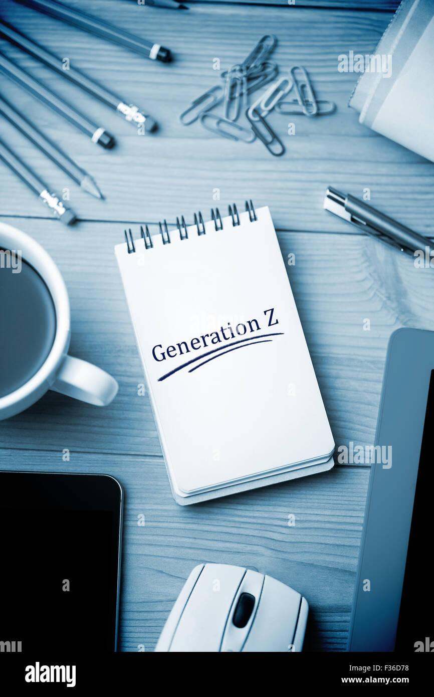 Generation z against notepad on desk - Stock Image