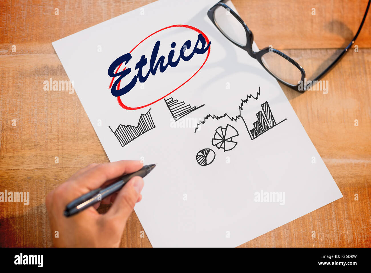 Ethics against business graphs - Stock Image