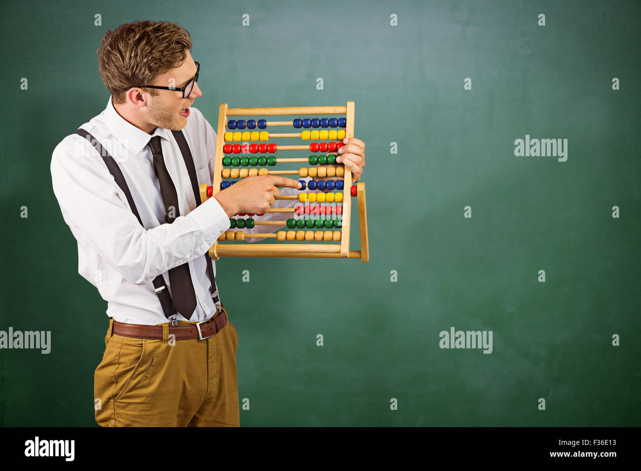 Composite image of geeky businessman using an abacus - Stock Image