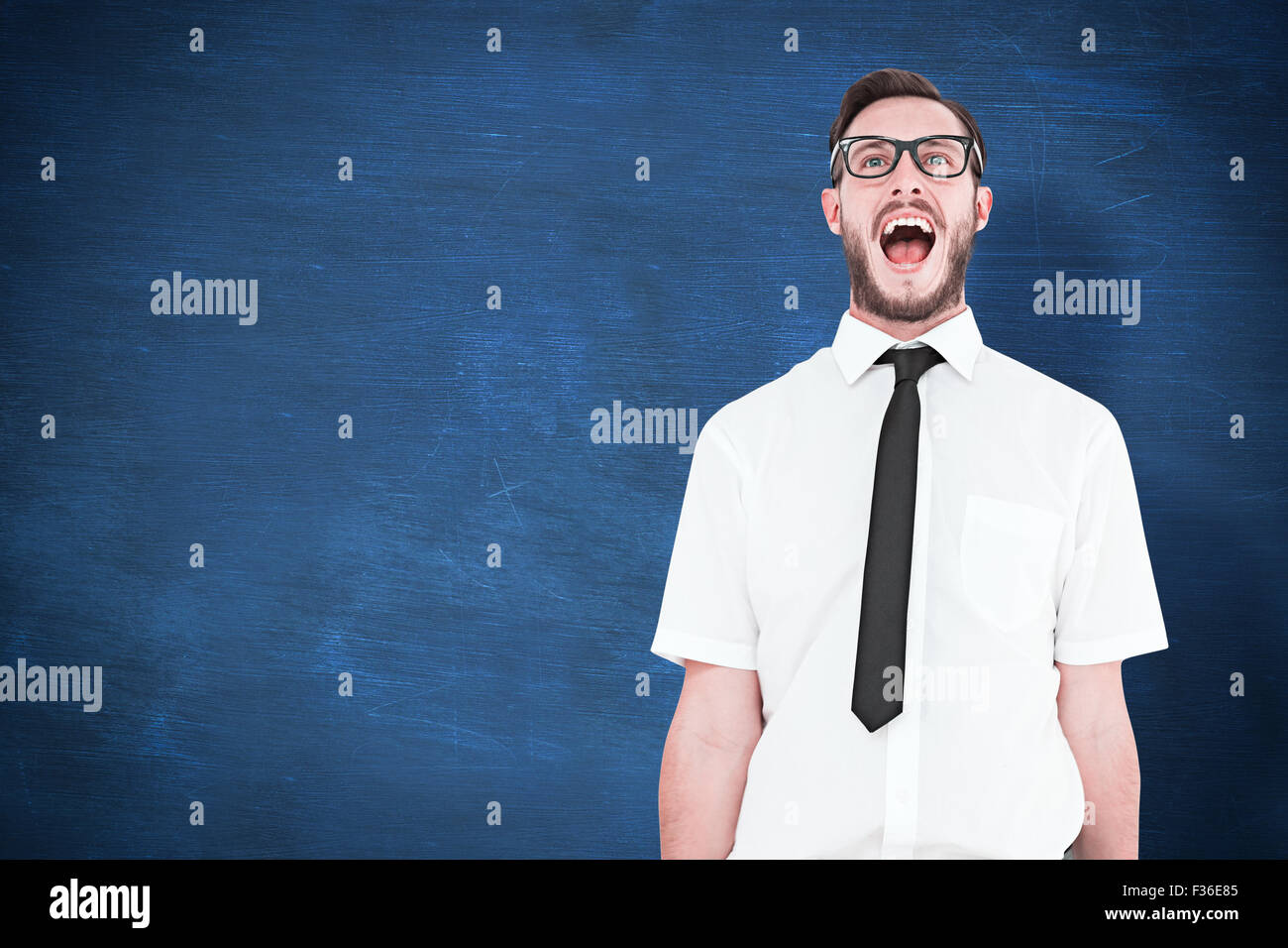 Composite image of geeky young businessman shouting loudly - Stock Image
