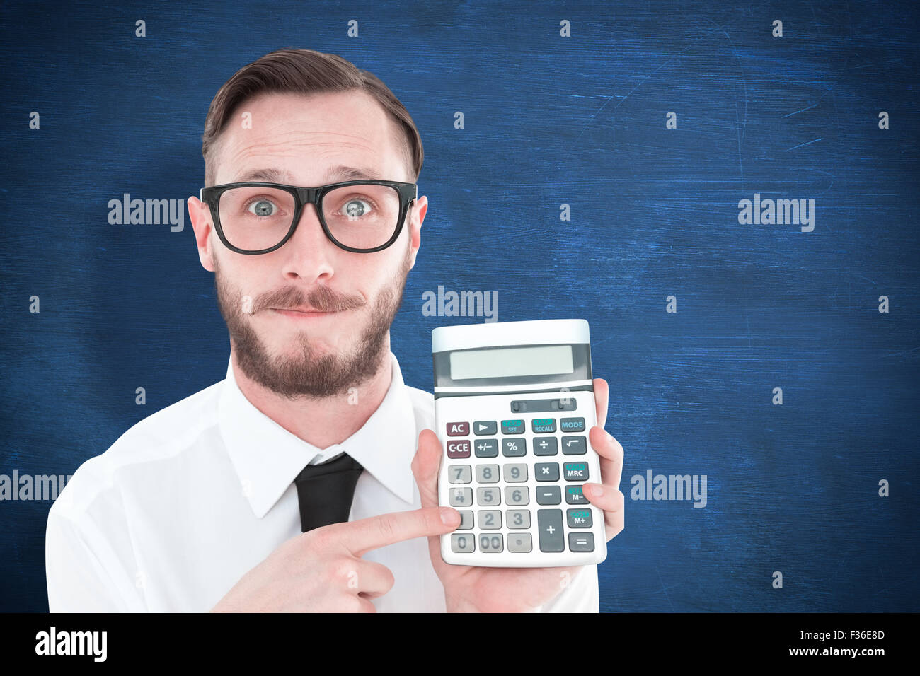 Composite image of geeky businessman pointing to calculator - Stock Image