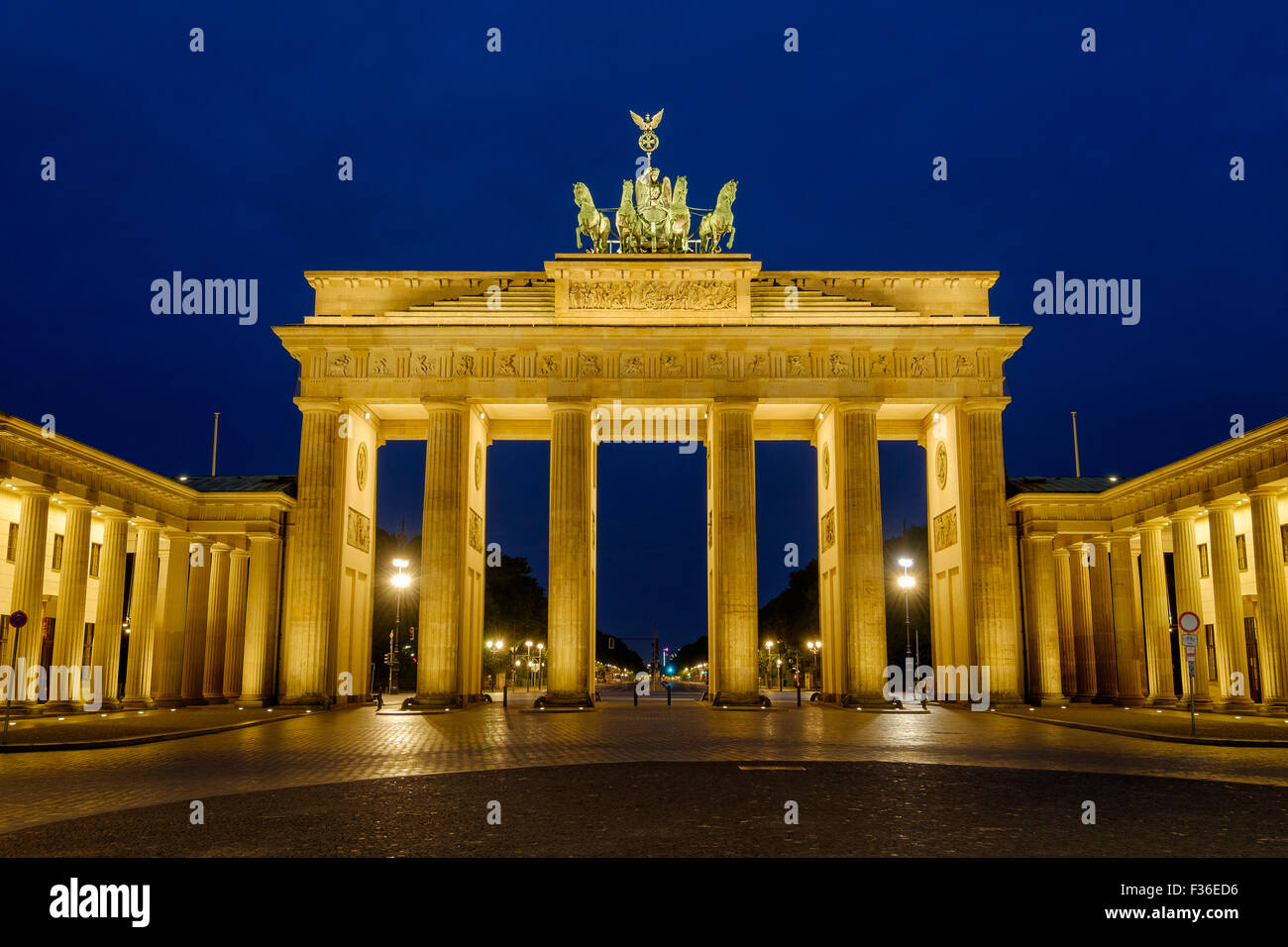 The Brandenburg Gate / Brandenburger Tor Berlin, Germany lit by floodlights in the early hours of the morning. - Stock Image