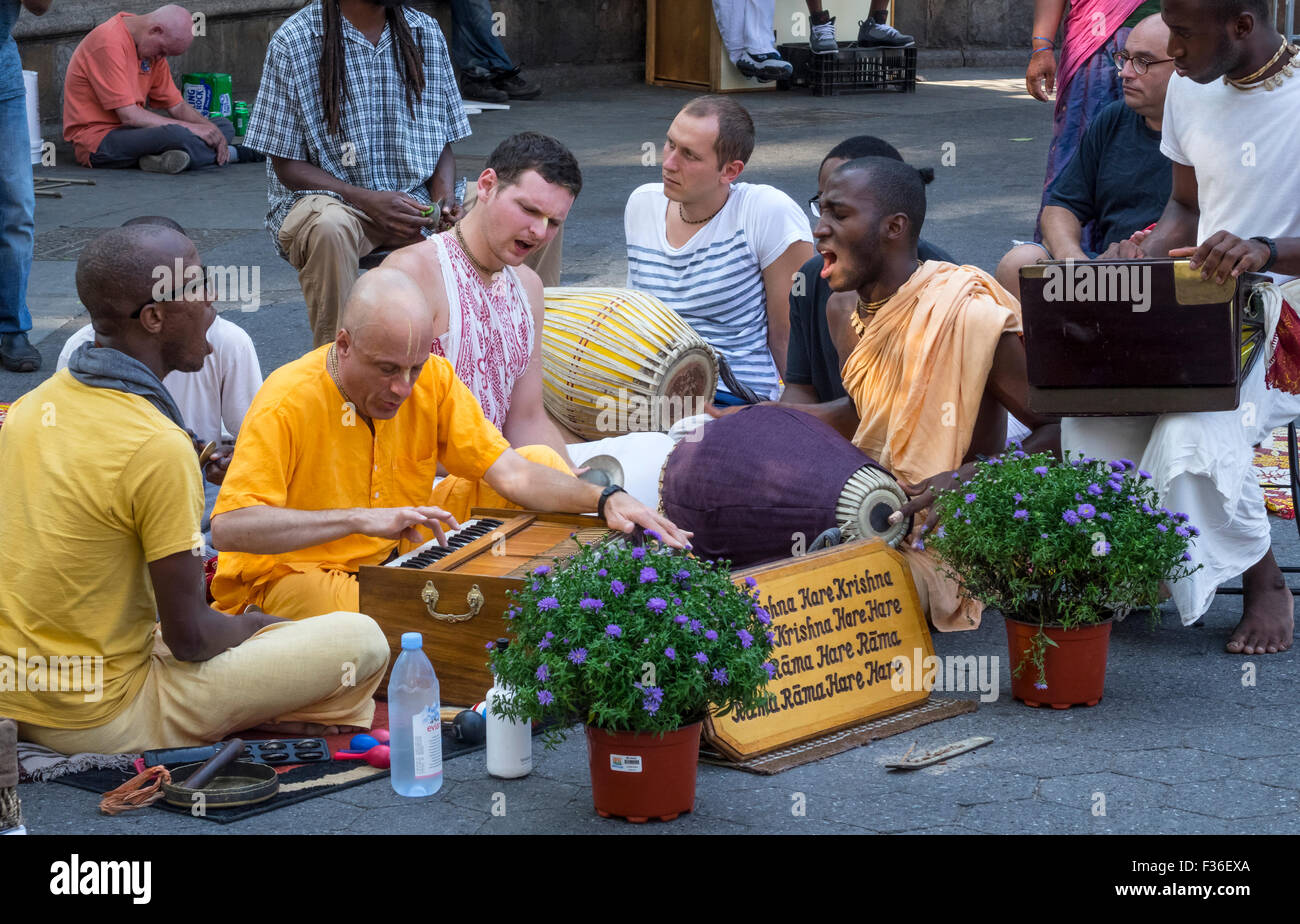 Followers of Hare Krishna singing the Maha Mantra in Union Square in Lower Manhattan in New York City - Stock Image