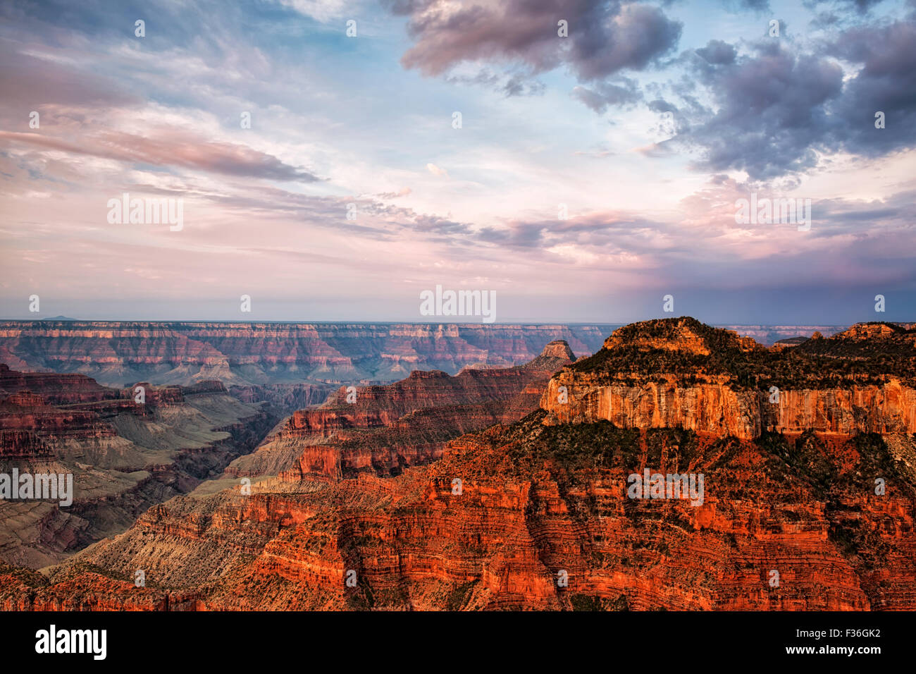 The warmth of sunrise light on the North Rim of Arizona's Grand Canyon National Park from Bright Angel Point. - Stock Image