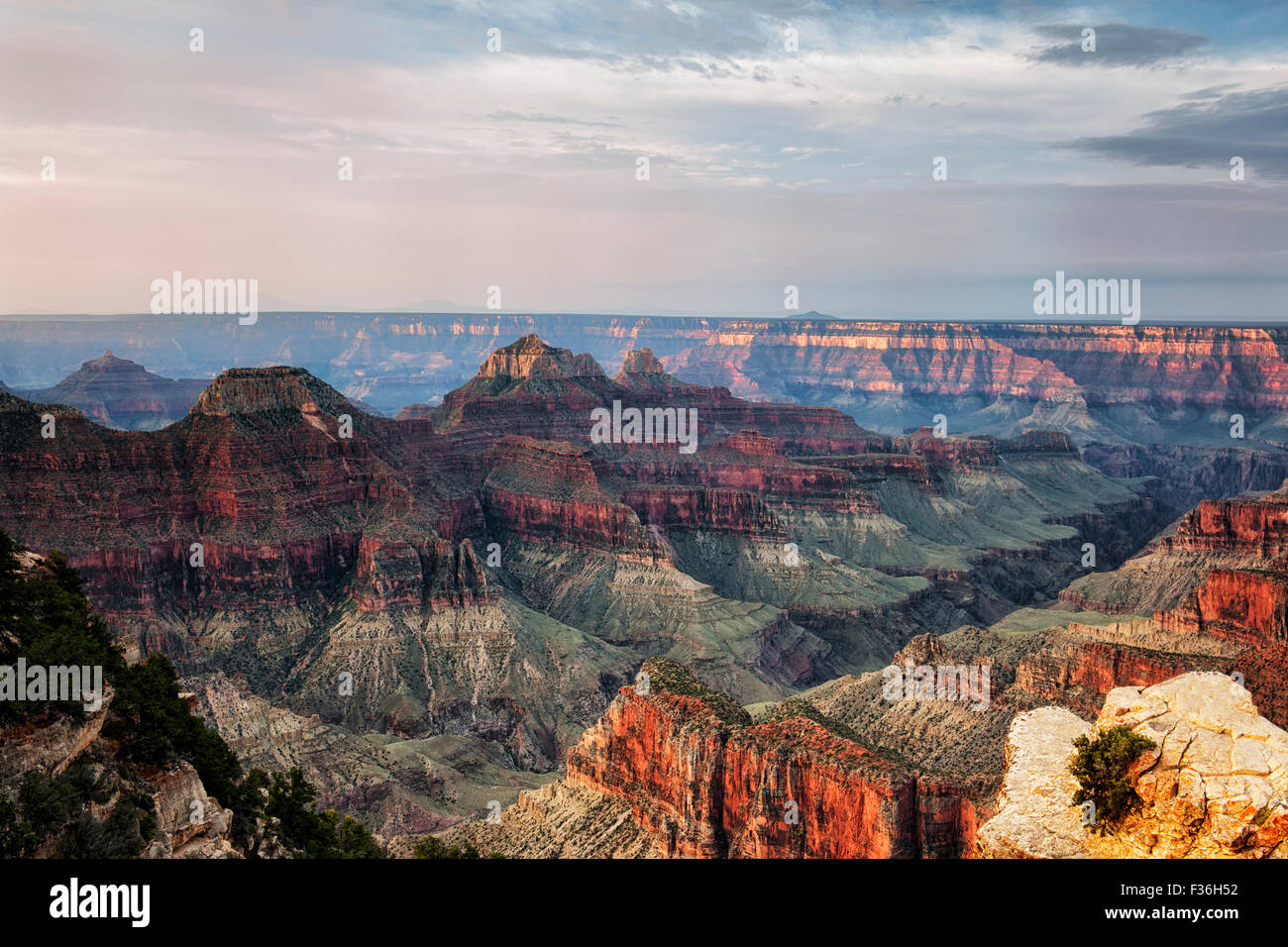 Early morning light warms up the North Rim from Bright Angel Point in Arizona's Grand Canyon National Park. - Stock Image