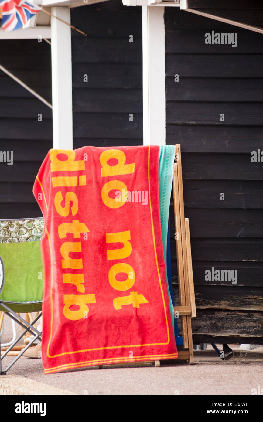 Please Do Not Disturb Towel Hanging On Deck Chair Outside Beach Hut At  Bournemouth In September