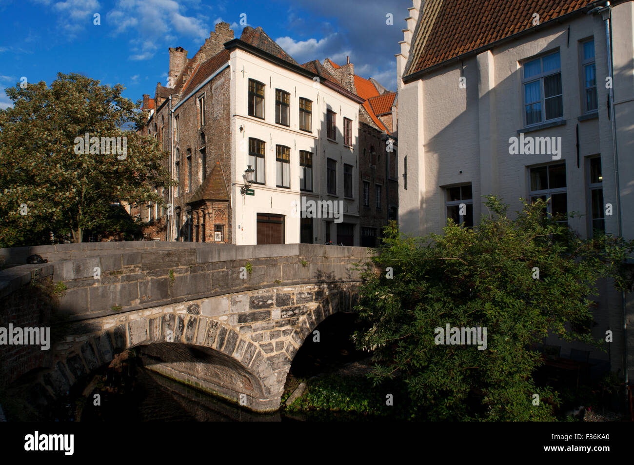 Bridge over one of the canals in Bruges, Belgium. Points of interest in Brugge are the more than 50 bridges that - Stock Image