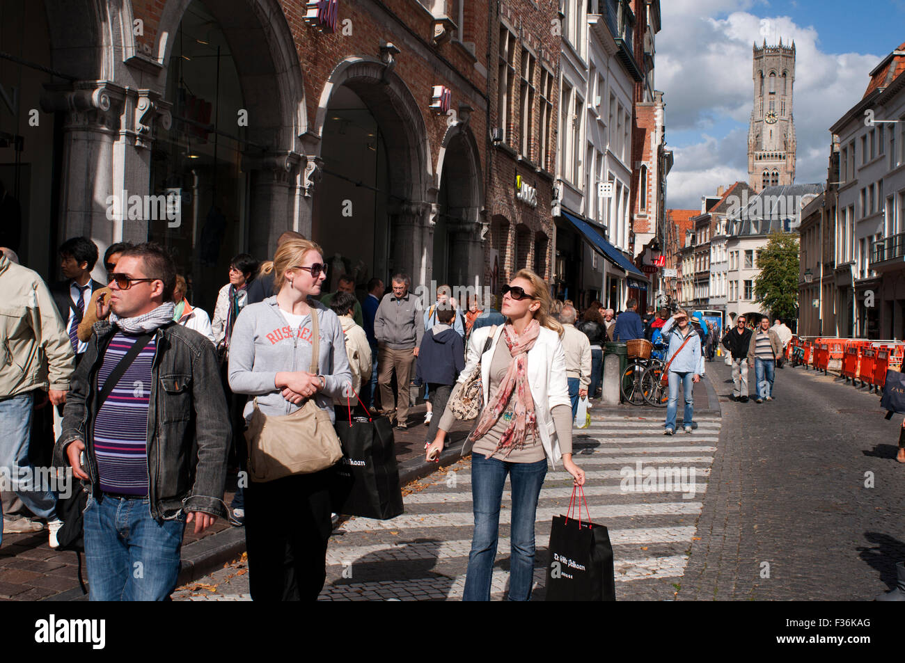Shopping in Bruges. Bruges' main shopping areas are situated between 't Zand and Markt Square - opening - Stock Image