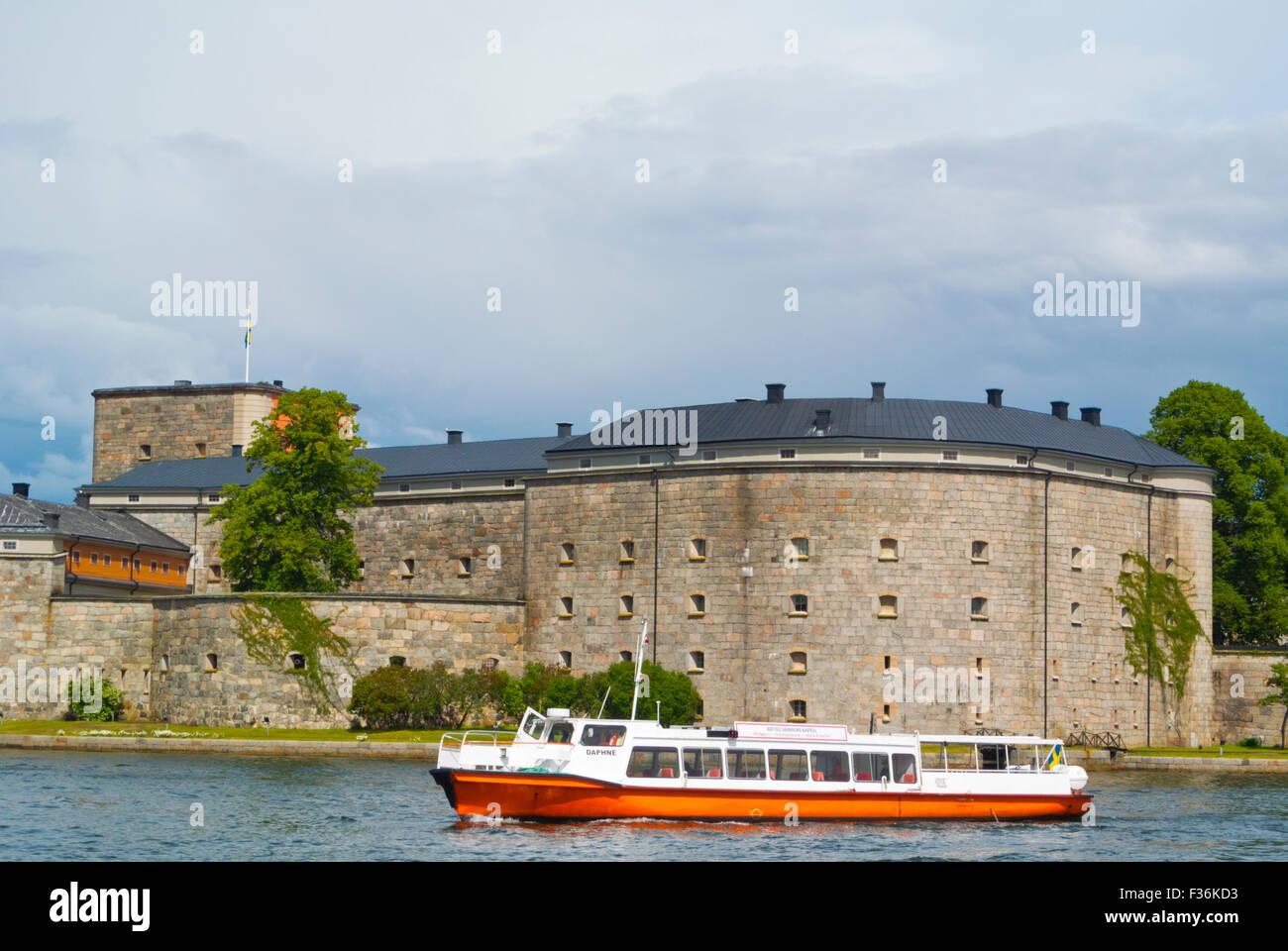 Boat in front of Kastellet, the fortress, Vaxholmen island, Vaxholm, near Stockholm, Sweden - Stock Image