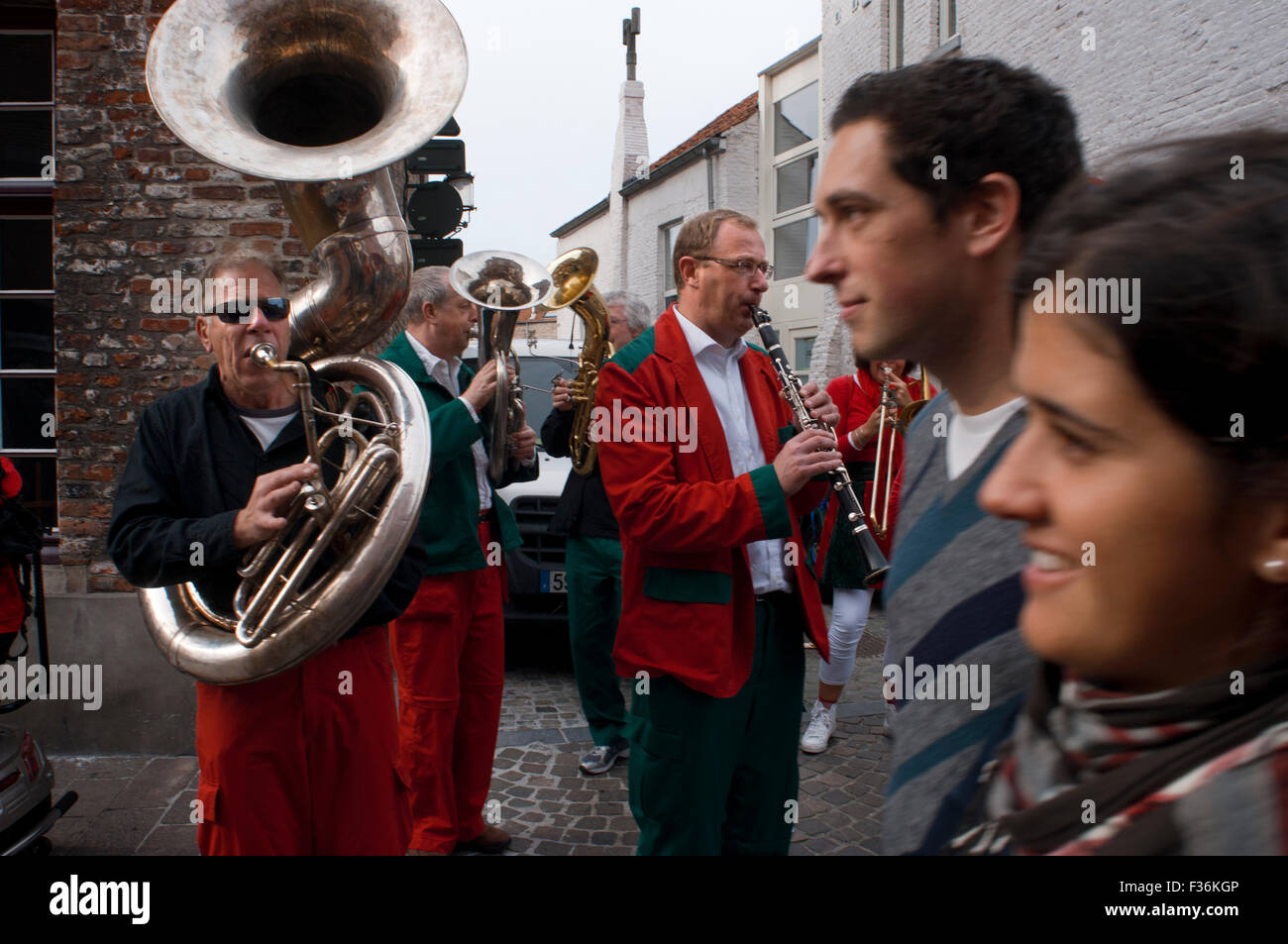 Music band on the Bruges streets. Bruges; Music; band; streets; building; buildings; center; centers; centre; centres; - Stock Image