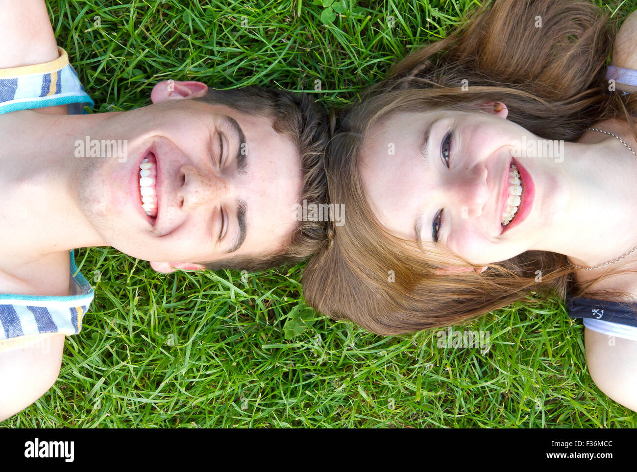 Happy, young couple on a meadow - Stock Image