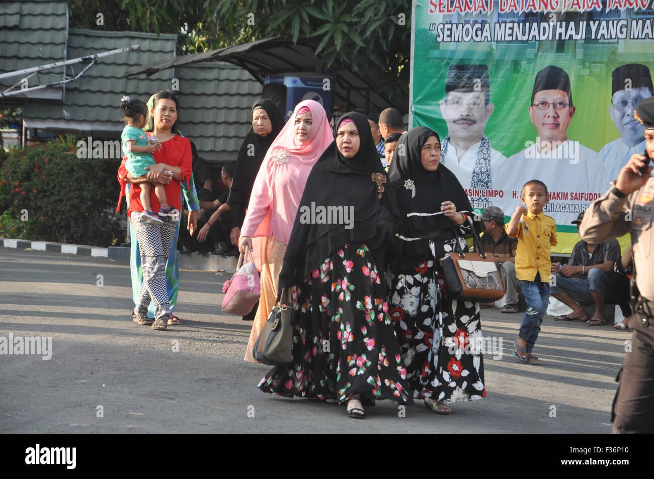 Makassar, Indonesia. 30th September, 2015. An Indonesian family walk at Sudiang Hajj Hostel Complex in Makassar, - Stock Image