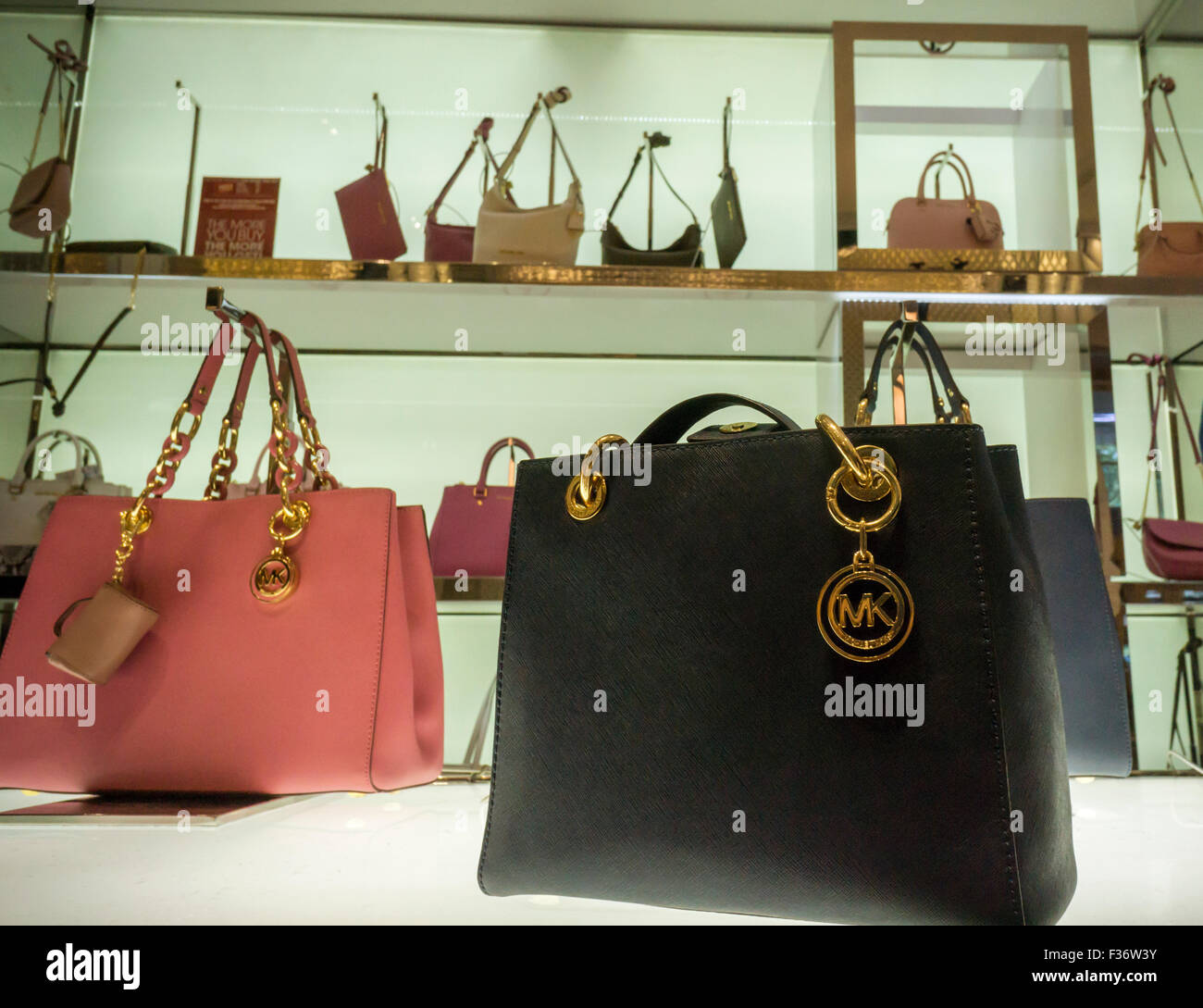 3d798e0c961e Handbags on display at the Michael Kors boutique within Macy's in New York  on Sunday,