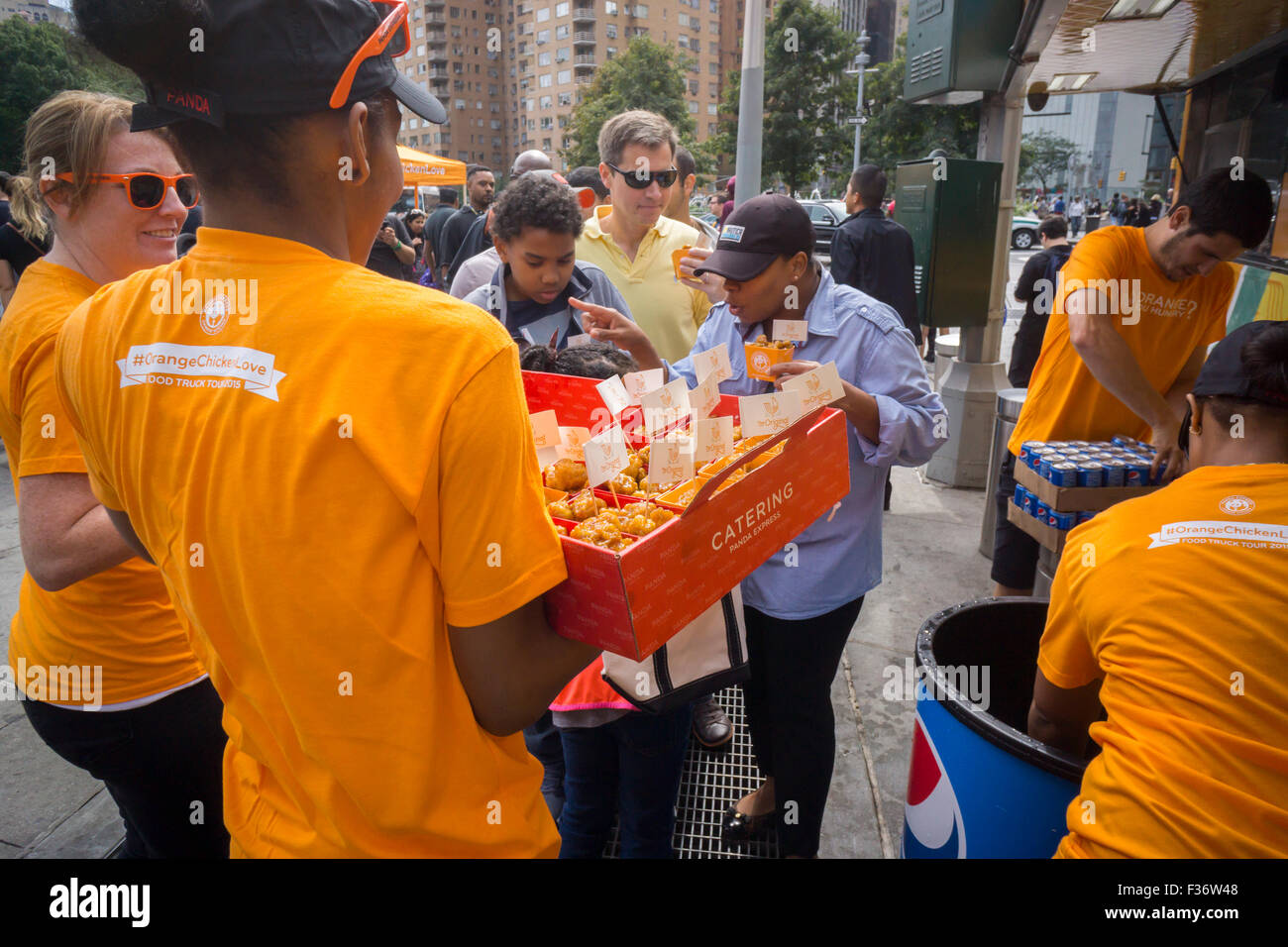 Hundreds eat samples of Panda Express' signature Orange Chicken at promotional event in Columbus Circle in New - Stock Image