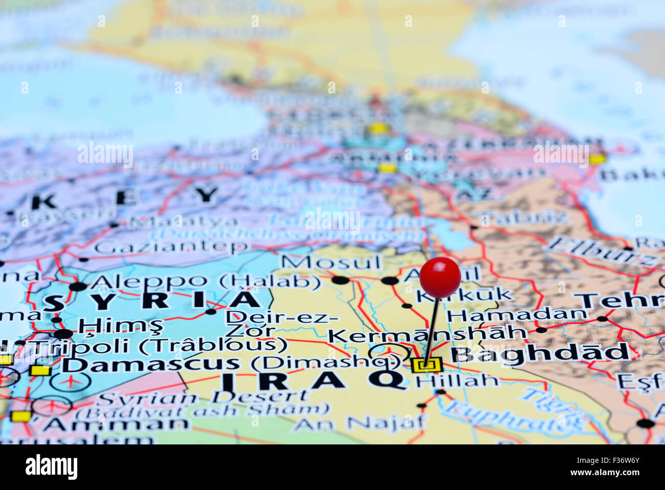 baghdad pinned on a map of asia stock image