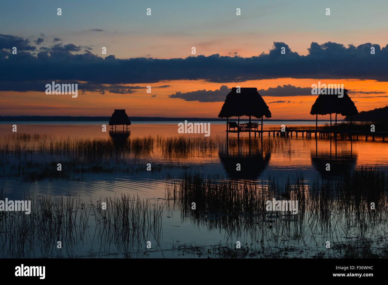 Sunset at the lake Peten Itza in El Ramate, Guatemala - Stock Image