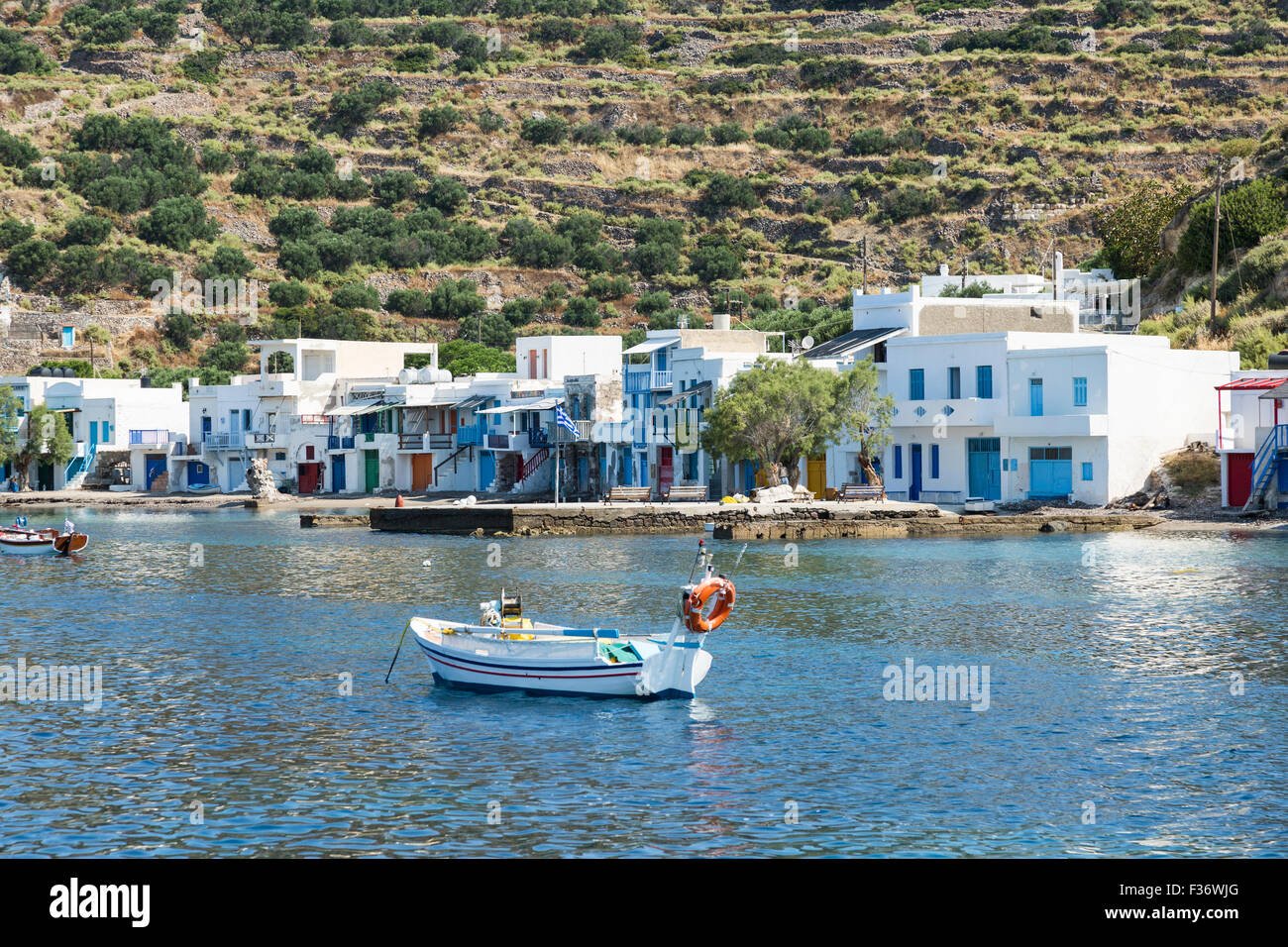 Kilma is a small fishing village with traditional shelters for boats on the Cyclades island of Milos Greece - Stock Image