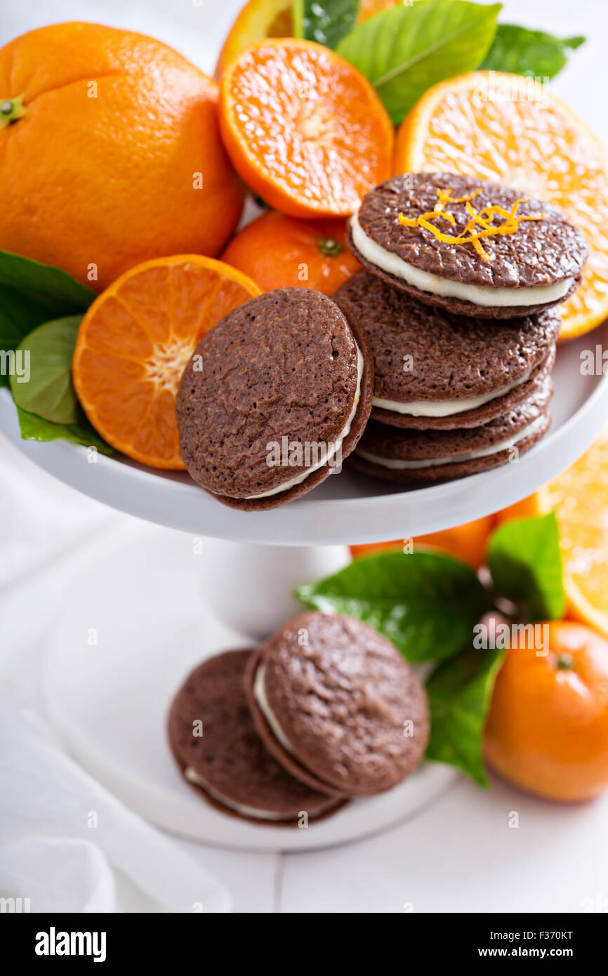 Chocolate orange thin brownie cookies with cream filling - Stock Image