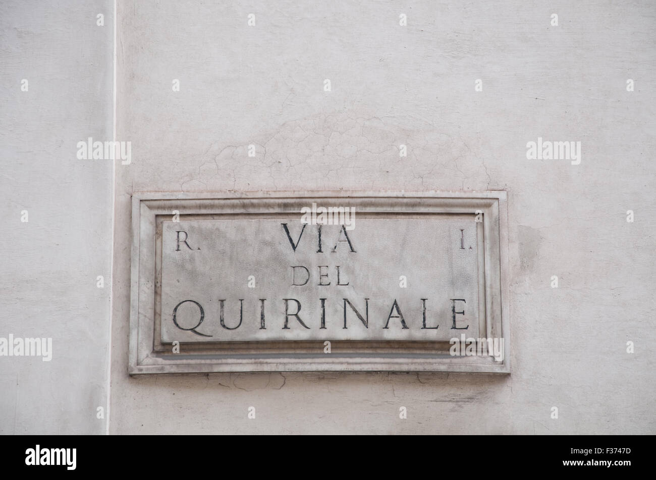 "Road sign indicating a street name in Italian ""piazza de quirinale"" in English means quirinale square Stock Photo"